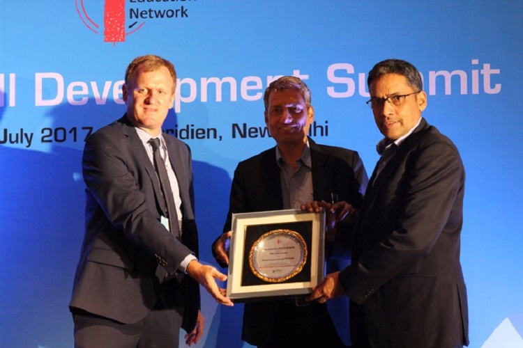 (Right to left) Mr Atul Jaiswal, President , CMC Skills receiving  the award for