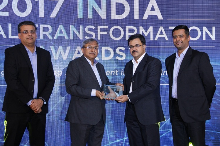 Mr. Hari Nair, Head Solution Engineering India and Mr. Vikesh Nair, Region Head for Direct Sales India, Tata Communications receiving the 'Enterprise Telecom Service Provider of the Year - Large Enterprise Segment' award from Mr. Sanjay Prasad, CIO, Tata Power Limited, in the presence of Mr. Y.S. Shashidhar, Managing Director & Partner, Frost & Sullivan - South Asia, Middle East & North Africa