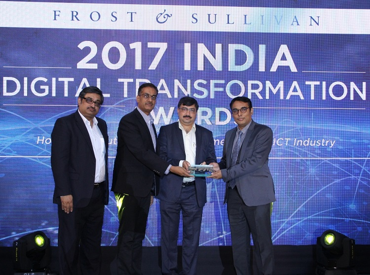 Mr. Anurag Mathur, Region Head for Direct Sales India, & Mr. Suhas Desai, Head of Commercial Operation for India, Tata Communications receiving the 'Third Party Datacenter Service Provider of the Year' award from Mr. Jignesh Gandhi, COO, Essel Finance Group, in the presence of Mr. Raghavendra Rao, Sr. Vice President, Frost & Sullivan
