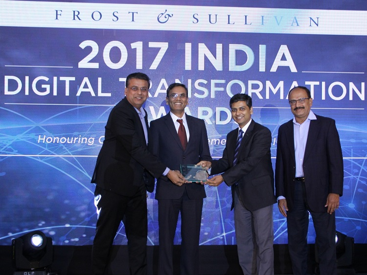 Mr. VS Shridhar, Head of IoT Business & Mr. Lalit Mishra, General Manager Strategic Sales – IoT, Tata Communications receiving the 'IoT New Product / Service Innovation' award from Mr. Y.S. Shashidhar, Managing Director & Partner, Frost & Sullivan - South Asia, Middle East & North Africa, in the presence of Mr. Pratap Gharge, Executive Vice President & CIO, Bajaj Electricals
