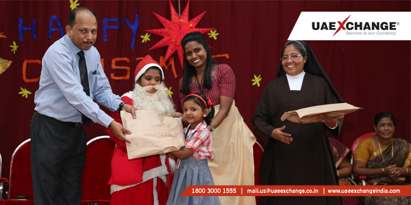 Mr. Prakash Bhaskar, National Head distributing Christmas gifts to the students