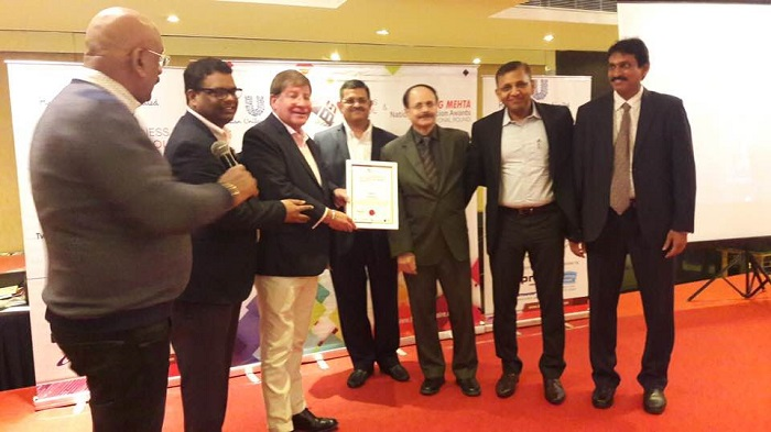 Ian Harris, President, DST IT Services receiving the Award along with Deepak Gupta, Head, Human Resources, DST