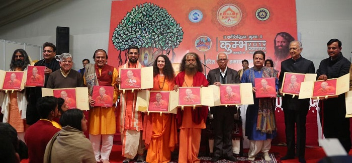 Launch of the book 'Simplicity & Wisdom' at Kumbh Mela 2019. In the presence of Keshari Nath Tripathi, the Hon'ble Governor of W. Bengal (4th from Right) Mr. Dinesh Shahra (4th from Left) Swami Chindanand and Sadhavi Bhagwati (Center).
