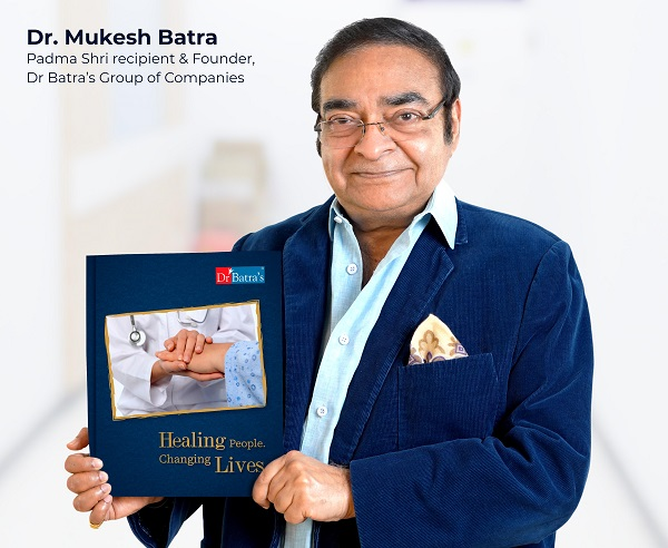 Dr Mukesh Batra, Padma Shri Recipient and Founder of Dr Batra's Group of Companies with his newly launched book - Healing People, Changing Lives