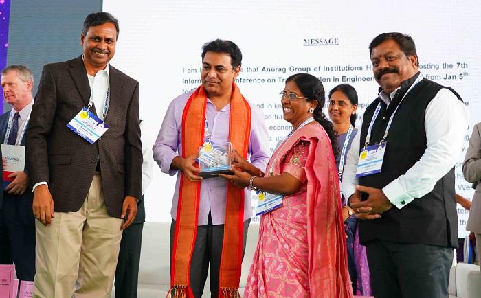 Dr. Palla Rajeshwar Reddy, Chairman, AGI and Mrs. S. Neelima, Secretary & Correspondent, AGI seen presenting a memento to Telangana IT&C Minister K. Taraka Rama Rao