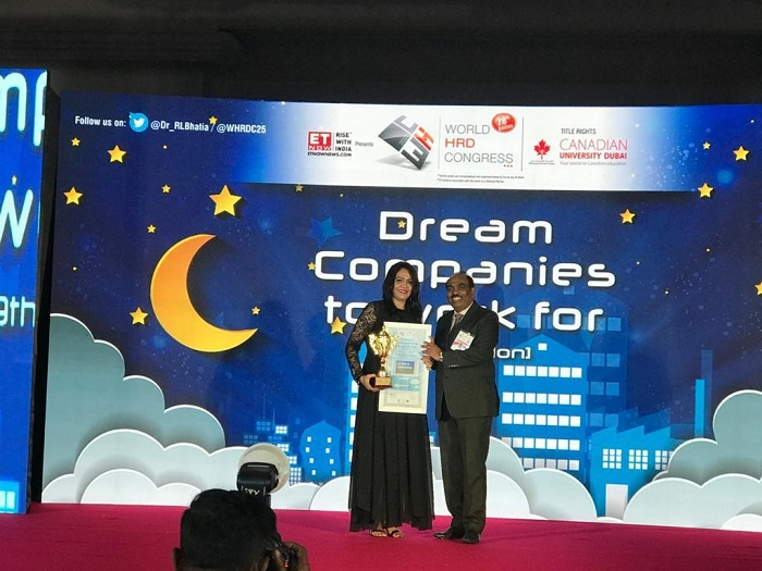 Maria Rajesh, Chief Human Resource Officer - Embassy Group, receives the award for 'Dream Company to work for in Real Estate'