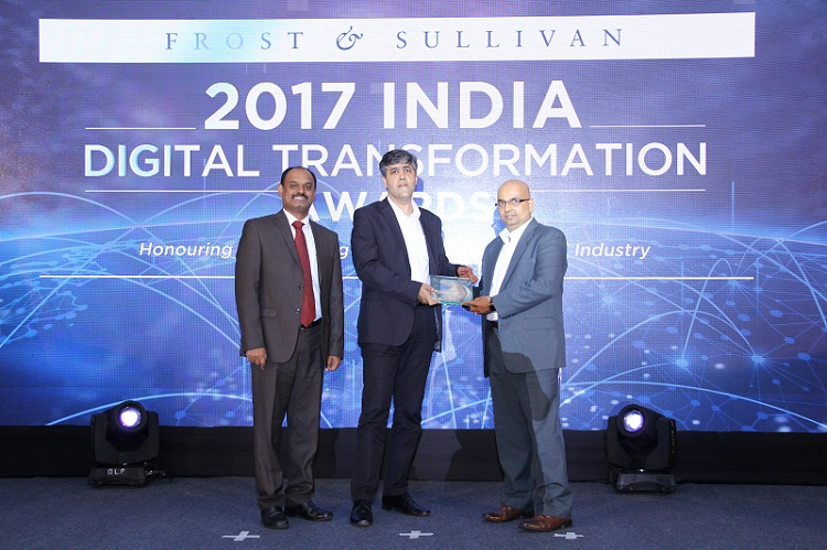 Mr. Vinayak Shenoy, Senior Solution Specialist, Unified Communications, Microsoft India receives the 'Unified Communications Application Vendor of the Year' award from Mr. Vikram Idnani, Chief Information Officer, Trent Limited, in the presence of Mr. Benoy C.S., Director & Business Unit Head, Digital Transformation (ICT) Practice, Frost & Sullivan