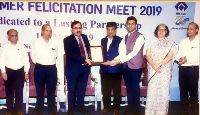 Mr. Ajay Kumar Bansal, Chairman and Managing Director, Hi-Tech Pipes Ltd., receiving