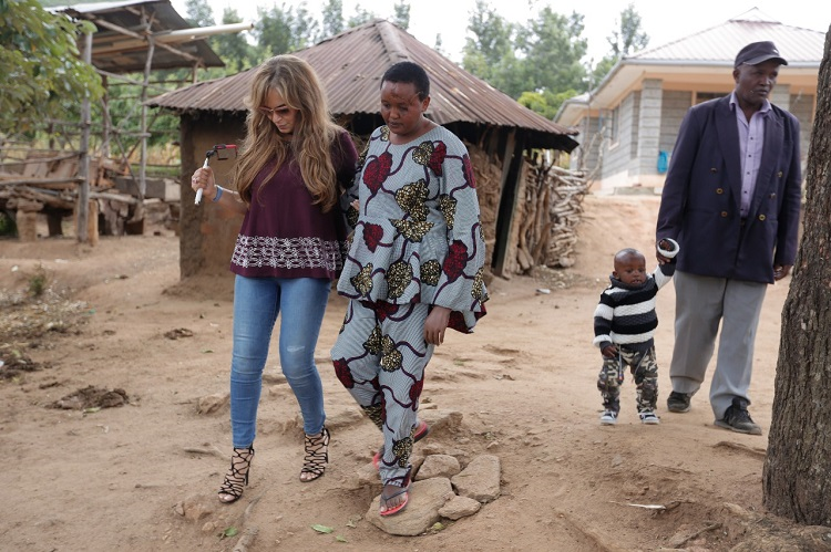 Dr. Rasha Kelej, CEO, Merck Foundation and President Merck more Than a Mother with Jackline Mwende outside the home build for her by Merck Foundation