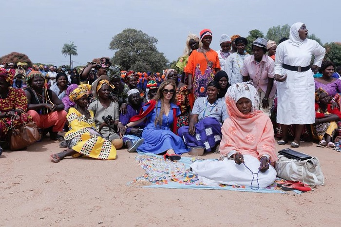 Dr. Rasha Kelej, CEO of Merck Foundation and President, Merck More Than a Mother with ladies from Gambia