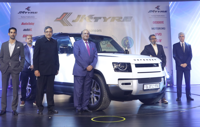 Dr. Raghupati Singhania, Chairman and Managing Director, JK Tyre & Industries presenting the 'Premium Car Award 2021 by ICOTY' to the 'Land Rover Defender' in the presence of the jury members in New Delhi
