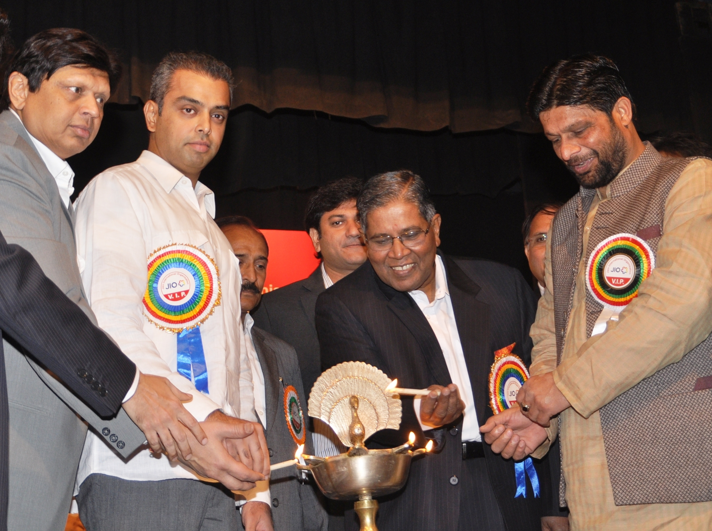 "Jain International Organisation (JIO) honoured 3 Central Government Ministers for their remarkable contribution in obtaining minority status for Jain community on 15th February 2014 at Mumbai. During lighting the lamp, Seen from L to R, Mr. Hemant Shah-Prominent Leader of JIO, Mr. Milind Deora- Central State Minister, Mr. K. Rahman Khan- Central Minister of Minority & Mr. Pradeep Jain ""Aditya"" –Central Rural Development Minister."