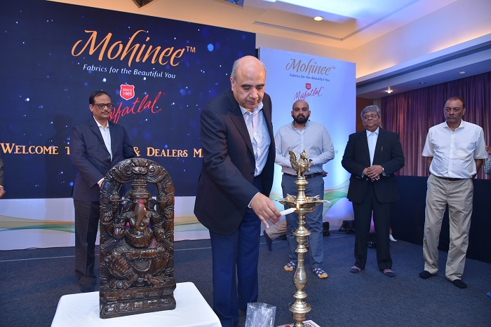 "Mafatlal Industries Ltd.(MIL) has launched ""Mohinee"" women's wear fabrics by Chairman Shri Hrishikesh Mafatlal during 'Mafatlal's Dealers & Agents Conference 2019', held from 19th to 21st August 2019 at Fariyas Resort, Lonavala. Seen left to Right - Mr. V. K. Maheshwari, President & Business Head of MIL, Shri Hrishikesh Mafatlal - Chairman of MIL (lighting the lamp), Shri Priyavrata Mafatlal, CEO & ED- MIL, Mr. Milan Shah - Group CFO- MIL and Mr. Sunil Shah, Agent for Maharashtra & Karnataka."