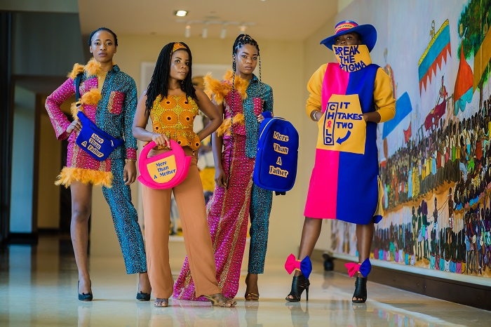 Winner of 'Merck More Than a Mother' Fashion Awards from Ghana - Ms. Augustina Annan with models exhibiting her winning designs