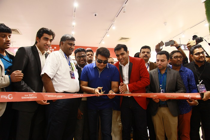 Padmashree Mohanlal, officially inaugurating South India's largest digital showroom, myG, at Kochi in the presence of AK Shaji- Chairman & Managing Director, TS Sridhar- Nokia, Anish CR- GM Marketing, Muhammed Nadir CKV - GM Operations, Mohammed Jaisal- State Head, Firoz KK- AGM Marketing, Jacob Jobin- Zonal Manager and KK Wahab- Purchase Head