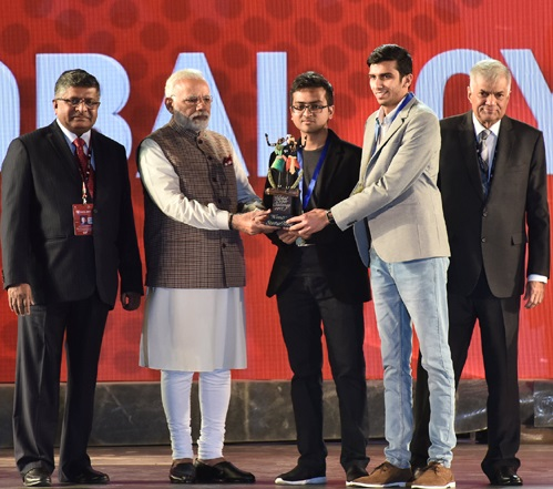 PM Modi felicitates Shikhil Sharma and Ananda Krishna from NIIT University (NU) at the Global Conference on Cyberspace (GCCS) 2017