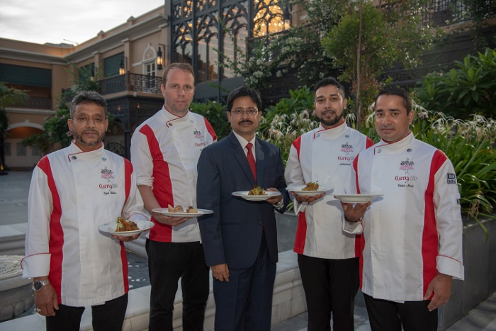 (L-R) Chef Zohorul Islam, Michelin Chef Mark Poynton, Chef Subrata Debnath Business Head & GM Raajkutir, Chef Mohammad Aaban Aamir Ali and Chef Mohamed Shahin Miah showcasing signature dishes of the Taste of Britain Curry Festival at Raajkutir Swabhumi