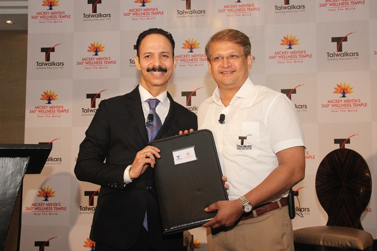 (From L to R) Global leading holistic health guru, Dr. Mickey Mehta signed the agreement with Mr. Prashant Talwalkar, MD & CEO of Talwalkars Better Value Fitness Limited