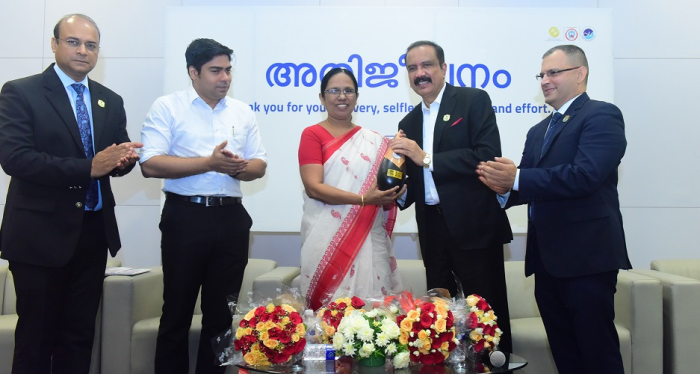 Dr Azad Moopen Founder Chairman and Managing Director, Aster DM Healthcare presenting memento of appreciation to Govt of Kerala for its support in effectively controlling Nipah to the Hon. Health Minister Shailaja Teacher in the presence of District Collector Suhas S IAS , Dr Harish Pillai, CEO Aster India and Cdr Jelson Kavalakkat, CEO - Aster Medcity, Kochi.