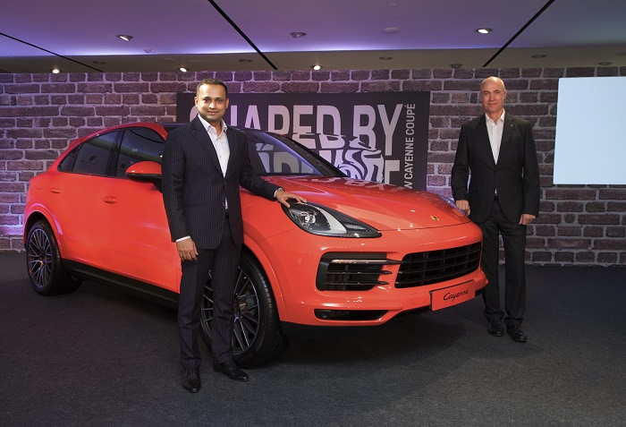Pavan Shetty Director - Porsche India and Dr. Manfred Bräunl CEO - Porsche Middle East and Africa FZE with the new Cayenne Coupé