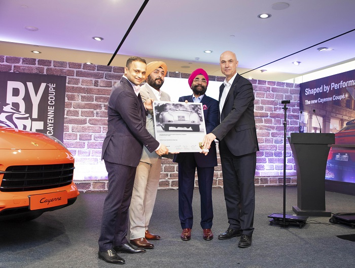 Porsche Centre Delhi-NCR opens its first showroom in Baani - the financial and tech-nology hub of Gurugram. Seen in the picture (L-R) Pavan Shetty – Director, Porsche India, Dilmohan Singh & Prithipal Singh – Owner's & Dealer Principal's, Porsche Centre Delhi-NCR and Dr. Manfred Bräunl - CEO of Porsche Middle East & Africa FZE
