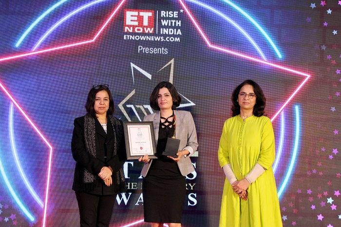 Priyanka Chatterjee, India Marketing Manager, Infor receiving the Award from the organizers
