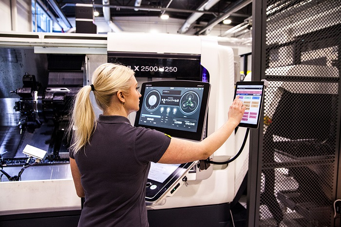 Operator input through operator panel close to the machine