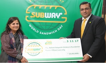 Mr Ranjit Talwar, Subway Country Director, South Asia handing over replica of a cheque for Rs. 1.5 million to Mrs Sumedha Kailash, a founder of the Kailash Satyarthi Children's Foundation in Gurugram. The amount was collected by Subway for welfare of underprivileged children in India on the occasion of the World Sandwich Day celebrated recently
