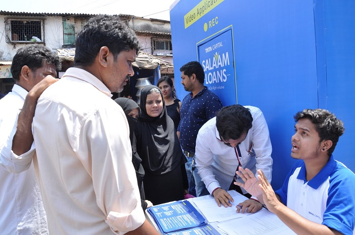 Individuals queuing up outside the Salaam Loans stall at Dharavi where deserving individuals can record their story
