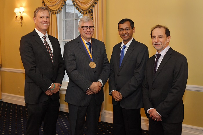 (L-R) Dean Andrew Ainslie, Professor Gregory H. Bauer, Srinath Sridharan (Member - Group Management Council -WGC) , President Richard Feldman (University of Rochester) after the investiture ceremony for the Rajesh Wadhawan Chair for Development Economics at Simon Business School