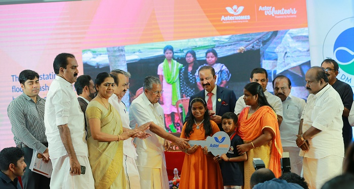 CM handing over the key to Aster Homes beneficiary Mini Surendran