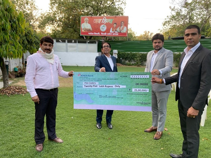 Mr. Sanjeev Kumar, Director - Asclepius Wellness Private Limited handing over the cheque to Mr. Manoj Tiwari, Member of Parliament