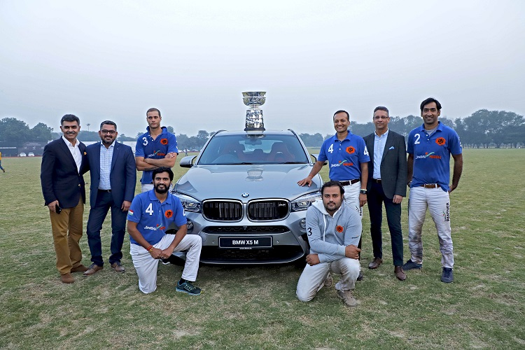 (L-R) Mr. Adhiraj Singh, CEO and Managing Director at Equisport, Mr. Mihir Dayal, Director, Marketing, BMW India, Winning team - Jindal Panthers and Mr. Vikram Pawah, President, BMW Group India.