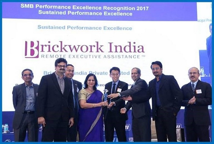 Brickwork Chairman, Vivek Kulkarni and CEO, Sangeeta Kulkarni by Patrick Lim, Director - Business & Service Excellence, SPRING Singapore in the presence of David Rasquinha, MD EXIM Bank of India, R Mukundan, MD Tata Chemicals Ltd and TT Ashok, MD Taylor Rubber P Ltd.