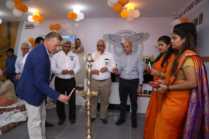 Mr. Neil Woodfin, CNH Industrial CE APAC Brand Leader lightning lamp to mark  inauguration of  CASE's first company owned showroom CASE NCR in Faridabad