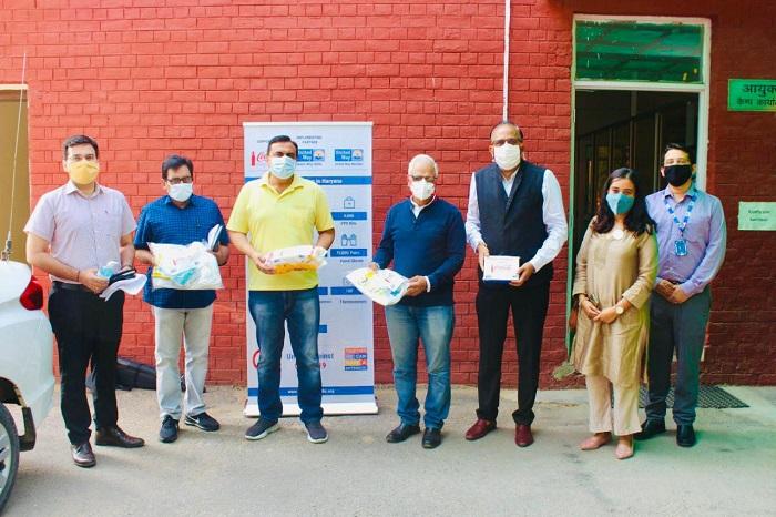 Coca Cola's partnership with United Way Mumbai for the distribution initiative takes place at the Division Commissioner Residence Office, Civil Lines, Gurugram. The dignitaries in the picture (Left to right) 1. Shri Amit Khatri, IAS, DC Gurugram, 2. Dr. Yadav, CMO, Gurugram, 3. Shri Ashok Sangwan, IAS, Divisional Commissioner Gurugram, 4. Shri V.S Kundu, IAS, CEO, GMDA, 5. Shri Kapil Kumria, United Way Delhi Board Chair, 6. Smt Pallavika Ahlawat, Lead-CoVID Task Force, United Way Delhi, 7. Shri Sachin Golwalkar, CEO, United Way Delhi