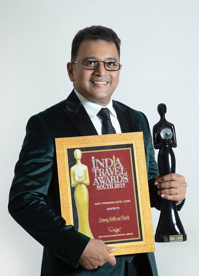 Yangya Prakash Chandran, Founder and Chief Executive Officer Crossway Hotels and Resorts with the award of the Most Promising Hotel Chain at the India Travel Awards South 2019