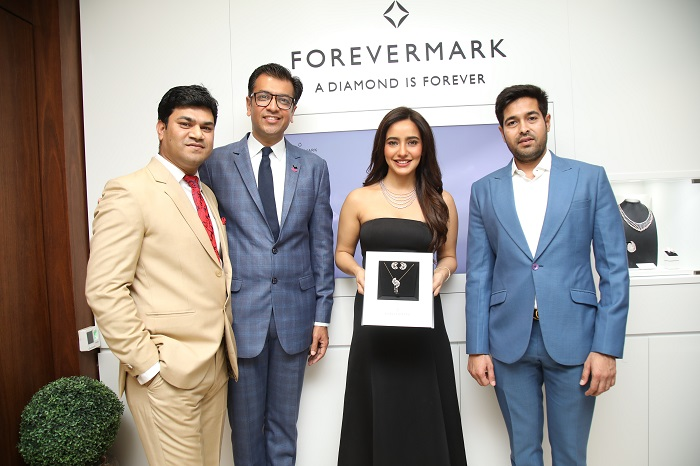 (L-R) Mr. Amit Bandi, CEO, DP Abhushan Ltd, Mr. Sachin Jain, President, Forevermark India, Actress Neha Sharma and Mr. Vikas Kataria, Managing Director, DP Abhushan Ltd.