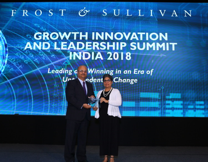Kiran Mazumdar-Shaw, Chairperson & Managing Director, Biocon Limited, honored with Frost & Sullivan's '2018 GIL Visionary Leadership Award' at GIL India 2018. Seema Ahuja, Global Head of Communications, Biocon Limited, receives the award on her behalf