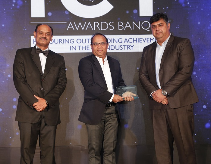 Mr. Jitendra Ghughal, Director, Channels – India & SAARC, Fortinet, receiving the 'Network Security Vendor of the Year' award from Mr. Achal Kataria, Vice President & Global Head of Technology, EXL, and Mr. Benoy CS, Vice President, Digital Transformation Practice, Frost & Sullivan