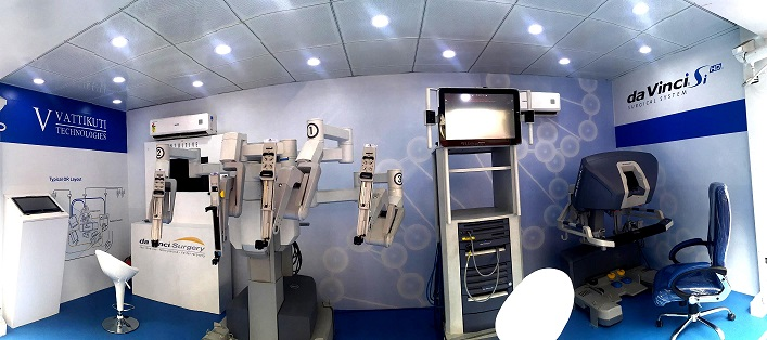 Surgical robot lounge with a four armed surgical robot, visual display and Surgeon console