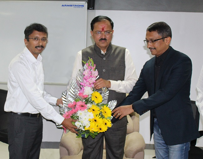 Mr Pranav Majgaonkar, Managing Director (Left), Mr Vineet Majgaonkar, Chairman (Right) welcomes Hon'ble Dr Subhash Bhamre Union Minister of State of Defence (Center) at Armstrong.