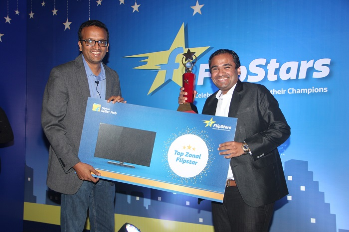 Mr. Purvesh Shah is seen here holding the award at the Flipstar Award ceremony