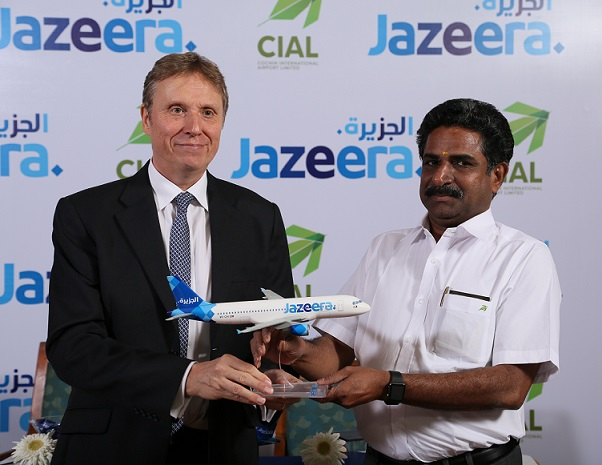 Andrew Ward, VP Marketing, Jazeera Airways gifting a memento to Mr. ACK Nair, Airport Director, CIAL