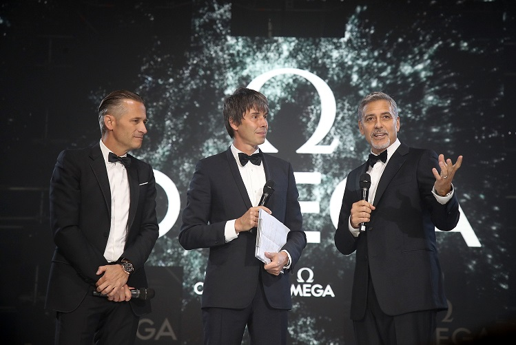"<b>OMEGA president Raynald Aeschlimann with brand ambassador and actor George Clooney at the celebrations of 60th Anniversary of Speedmaster collection in London</b>""></td> </tr> <tr> <td width="