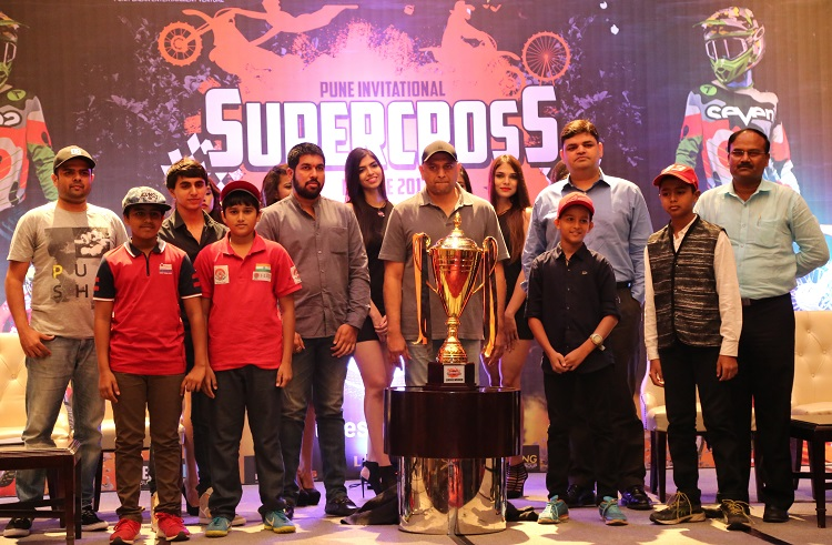 (Left to Right) Eeshan Lokhande, Managing Partner & Event Director, VILO Events along with Atul Chordia of Panchshil along with Junior Riders and Team owners at the trophy unveiling of Pune Invitational Supercross League 2017 held at Pune