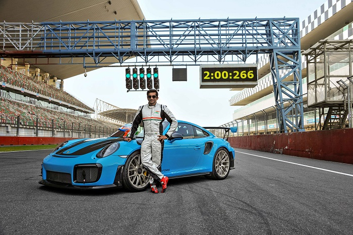 Narain Karthikeyan, India's first F1 Driver, set a new lap record for street-legal cars at the Buddh International Circuit in the 911 GT2 RS
