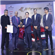 Dr. Raghupati Singhania, Chairman and Managing Director, JK Tyre & Industries presenting the 'Indian Car of the Year 2021' award to Mr. S S Kim, MD & CEO, Hyundai Motor India Limited for the 'Hyundai i20' in the presence of the jury members in New Delhi