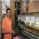 A weaver in Varanasi, Uttar Pradesh gets his first pair of eyeglasses from VisionSpring