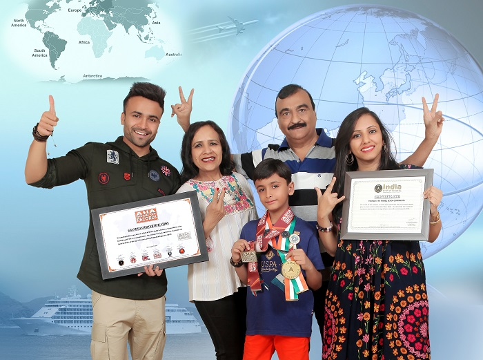 Vivaan and his family with India Book of Records and Asia Book of Records for being 'The youngest Indian to travel all continents of the world'